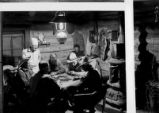 Five men gamble in old bunkhouse that Otto Franc built on Pitchfork Ranch
