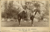 Buck Taylor mounted on a horse
